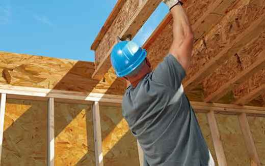 Image of man installing engineered lumber